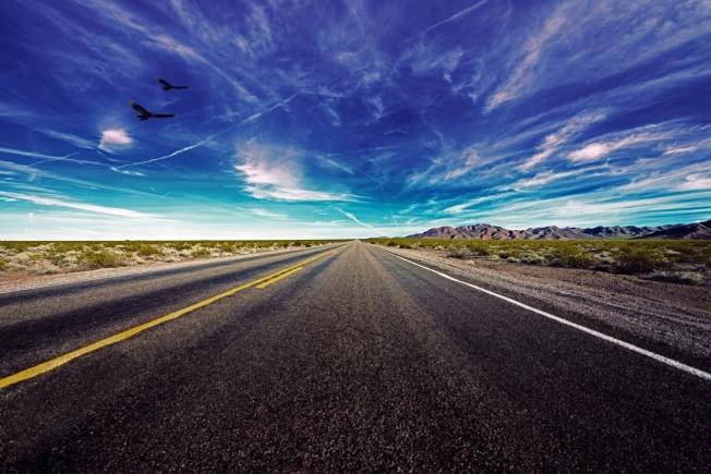 desert-road-under-cloudy-skies